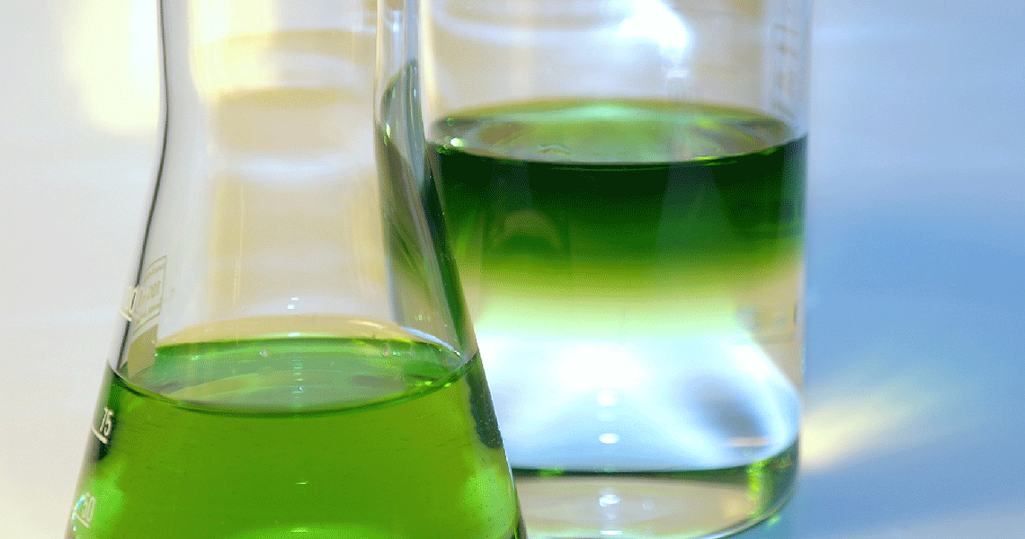 Green Liquid in Beaker - HRS Industrial Solvents
